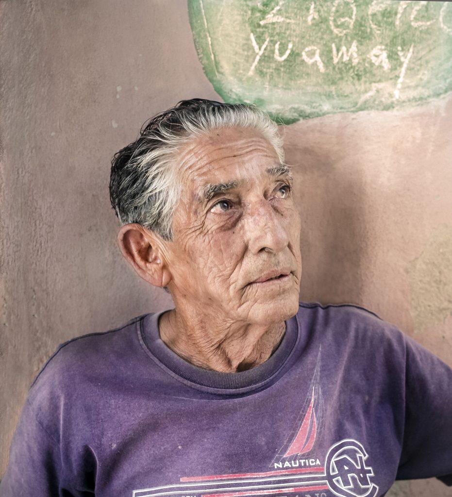 Old man on street not far from Julienne