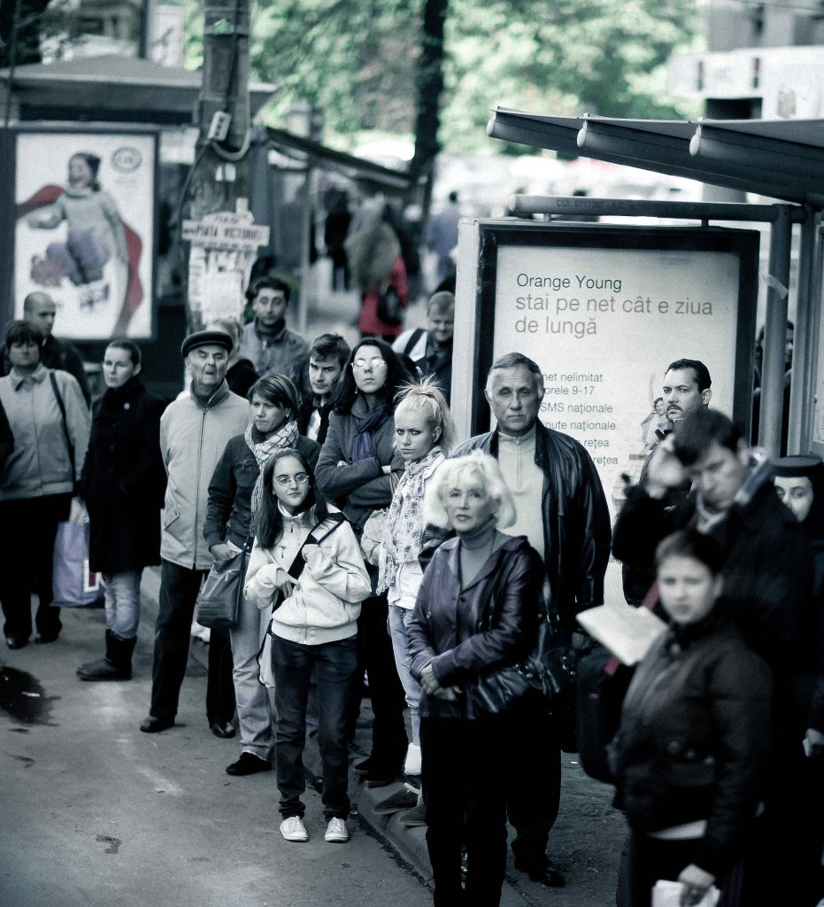 Crowd at Bus Stop in the French Capital