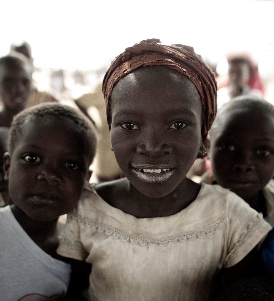 Children gathered around photographer in Ghana